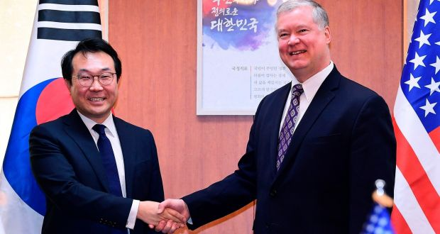 fbd7730ee Stephen Biegun (R) shakes hands with South Korea s special representative  for Korean Peninsula Peace