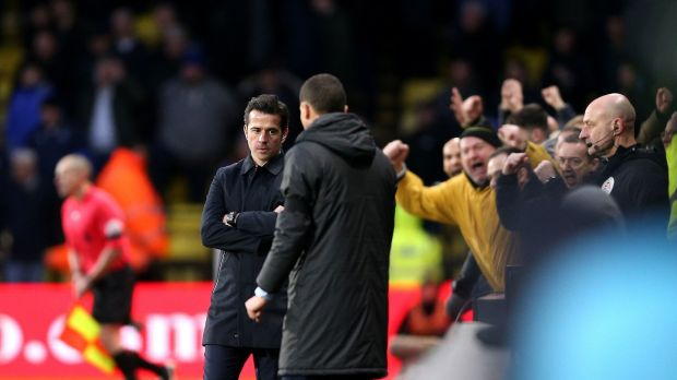 Watford fans celebrate as Everton manager Marco Silva looks on. Photo: Nigel French/PA Wire