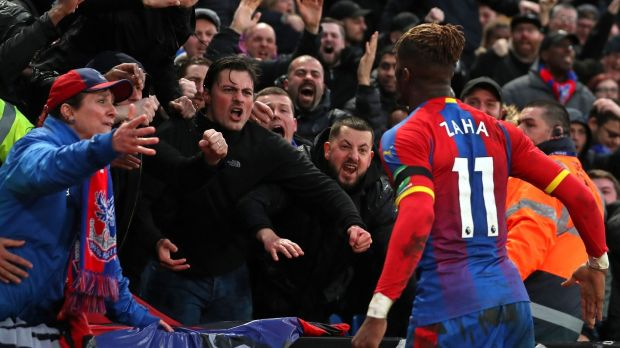 Wilfried Zaha celebrates after bagging a late equasliser for Palace. Photo: Daniel Leal-Olivas/Getty Images