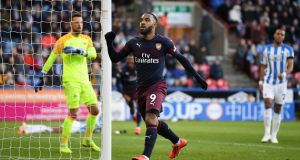 Alexandre Lacazette of Arsenal celebrates after scoring his team's second goal during the Premier League win over Huddersfield. Photo: Gareth Copley/Getty Images