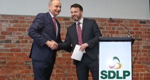 Fianna Fáil leader Micheál Martin and SDLP leader Colum Eastwood at the launch of the new partnership in Belfast. File photograph: Niall Carson/PA Wire