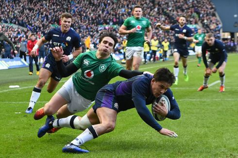 Scotland's centre Sam Johnson scores his team's first try during the Six Nations international rugby union match between Scotland and Ireland. Photo by ANDY BUCHANAN / AFP/Getty Images