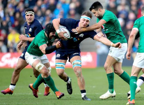 Ireland's Jamie Ritchie is tackled by Sean O'Brien and Conor Murray of Scotland. Credit INPHO/Billy Stickland