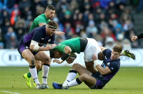 Bundee Aki of Ireland is tackled by Huw Jones and Simon Berghan of Scotland during the Guinness Six Nations match between Scotland and Ireland.  Photo by David Rogers/Getty Images