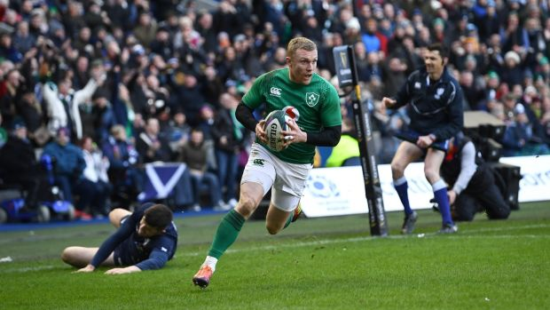 Keith Earls skates in to score Ireland's third try against Scotland. Photograph: Stu Forster/Getty