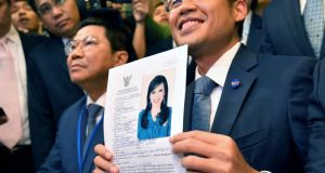 Thai Raksa Chart Party leader Preechapol Pongpanich (R) shows a document nominating Princess Ubolratana as candidate for prime minister. Photograph: EPA/STR