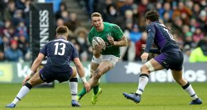 Ireland's Chris Farrell  takes on Huw Jones and Sam Johnson of Scotland during the Six Nations clash at Murrayfield. Photograph: David Rogers/Getty Images