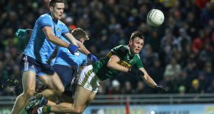 Kerry's Gavin O'Brien tackled by Brian Fenton and Michael Fitzsimons of Dublin at the Allianz Football League division 1 match at, Austin Stack Park. Photograph: Lorraine O'Sullivan/Inpho