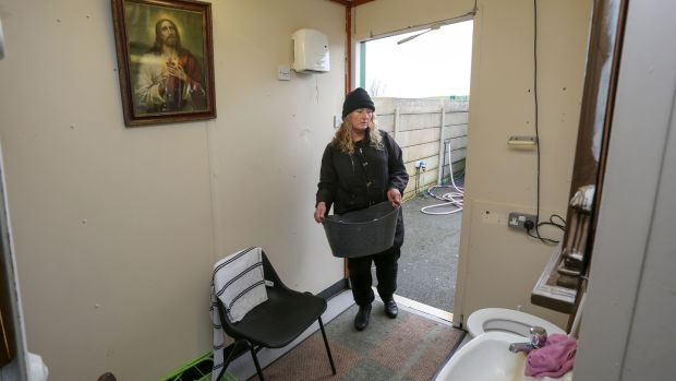 Margaret Delaney in the toilet and washing area in one of the units at the Carrowbrowne temporary halting site in Galway. Photograph: Joe O'Shughnessy