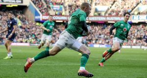 Ireland's Keith Earls scores a try after a pass from Joey Carbery. Photograph: Dan Sheridan/Inpho