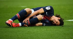 Paris Saint-Germain's Edinson Cavani could miss the Champions League clash with Manchester United on Tuesday. Photo: Getty Images