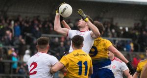 Tyrone win the contested hop ball that was an initally given as a free-in to Roscommon. Photograph: Evan Logan/Inpho