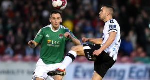 Dundalk's Michael Duffy and Cork City's Conor McCarthy compete for the ball during Saturday's President's Cup clash at Turner's Cross. Photo: Ciaran Culligan/Inpho