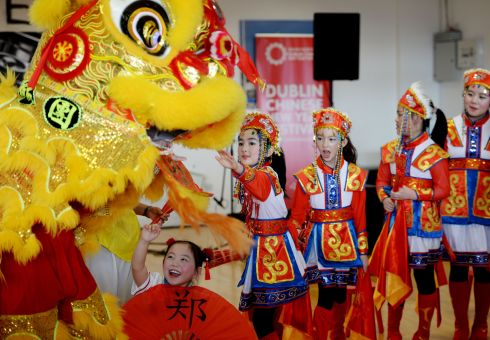 YEAR OF THE PIG: Members of the Chinese Irish Cultural Academy performing a traditional Chinese Dragon Dance to ring in the Chinese New Year, marking the Year of the Pig, at Dublin's CHQ. Photograph: Alan Betson/The Irish Times