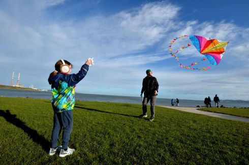 GO FLY A KITE: Annabel Purdy and Tim Purdy from Sandymount  in Dublin enjoy blue skys and windy weather on the shorefront at Sandymount Strand. Photograph: Alan Betson/The Irish Times