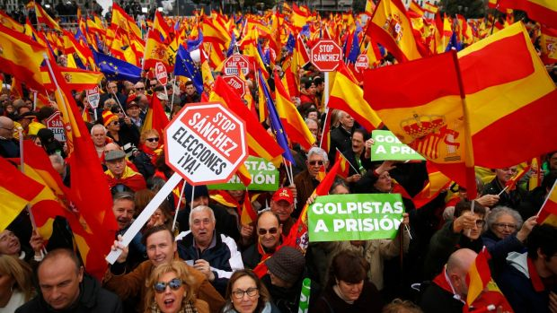 Demonstrators hold banners and Spanish flags during a protest in Madrid, Spain, on Sunday. Photograph: AP Photo/Andrea Comas