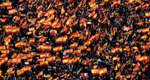 Protesters wave Spanish flags during a demonstration  in Madrid against the government of Spanish prime minister Pedro Sánchez. Photograph: Pierre-Philippe Marcou/AFP/Getty Images