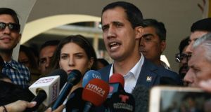 Venezuela's self-proclaimed acting president Juan Guaidó speaks to journalists after attending Mass in Caracas on Sunday. Photograph: Federico Parra/AFP/Getty Images