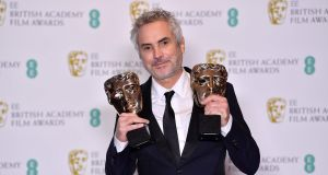 Director Alfonso Cuaron with the awards for director and for best film for 'Roma' at the 2019. Ben Stansall/AFP/Getty Images