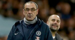 Chelsea manager Maurizio Sarri and behind him, Manchester City's manager Pep Guardiola at the Etihad Stadium. Photograph: PA