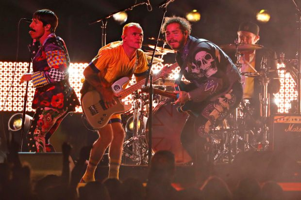 Anthony Kiedis and Flea of The Red Hot Chili Peppers perform with Post Malone. Photograph: Mike Blake/Reuters