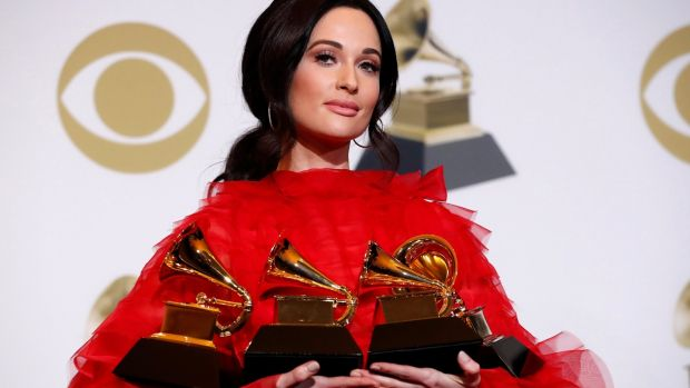 Kacey Musgraves poses backstage with her four awards, including for Album of the Year for Golden Hour. Photograph: Mario Anzuoni/Reuters