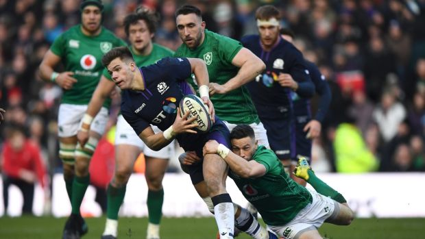 Scotland's Huw Jones is tackled by John Cooney of Ireland. Photograph: Stu Forster/Getty Images