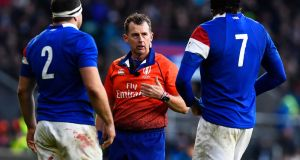 Referee Nigel Owens speaks to French players Guilhem Guirado and Arthur Iturria in Twickenham. Photograph: EPA