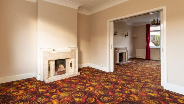 Interconnecting reception rooms with 1930s Art Deco-ish fireplaces