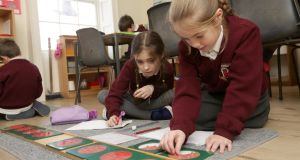 Martha Higgins (left) and Sophie Bradshaw in class at The Georgian Montessori Primary School in Belvedere Place, Dublin. Photograph: Laura Hutton