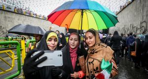 An Iranian woman takes selfies during a ceremony to mark the 40th anniversary of the Islamic Revolution in Tehran on Monday. Photograph: Vahid Ahmadi/Tasnim News Agency via Reuters