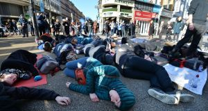 "Campaigners stage a mass ""die-in"" in Dublin city centre on Sunday, urging the Government to take urgent action to prevent climate breakdown.  Photograph: Alan Betson"