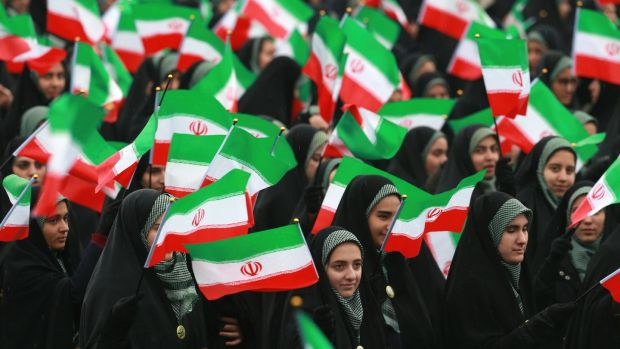 Iranians wave national flags during a ceremony celebrating the 40th anniversary of the Islamic Revolution, at Freedom Square, in Tehran, Iran. Photograph: Vahid Salemi/AP Photo