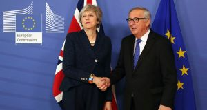European Commission president Jean-Claude Juncker shakes hands with UK prime minister Theresa May. Photograph: Francisco Seco/AP