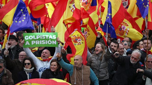 People gather during a protest called by right-wing opposition parties against Spanish prime minister Pedro Sanchez at Colon Square in Madrid. Photograph: Sergio Perez