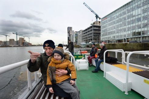 FIRST FERRY: Neil Kedward from Castleknock in Dublin with his grandson Isaac Walsh (4) on the number 11 Liffey Ferry's inaugural day of service. Photograph: Dara Mac Donaill / The Irish Times