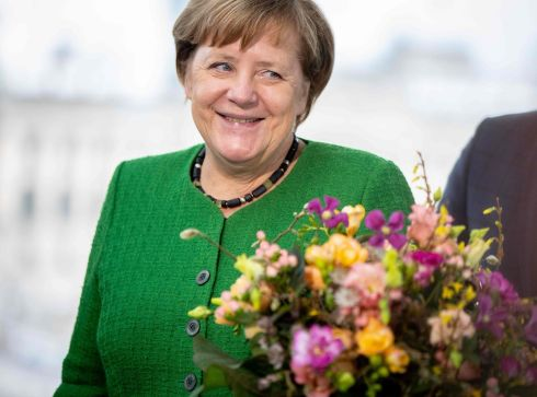 EARLY BLOOMS: Chancellor Angela Merkel is offered early flowers for Valentine's day, by the German central horticultural association in Berlin. Photograph: Kay Nietfeld/dpa/AFP/Getty Images