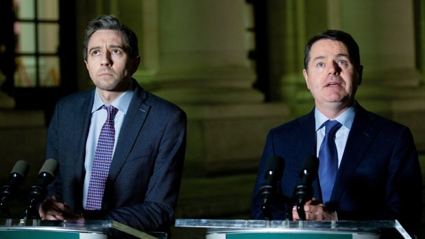 Minister for Health Simon Harris and Minister for Finance Paschal Donohoe outside Government Buildings on Monday night. Photograph: Tom Honan