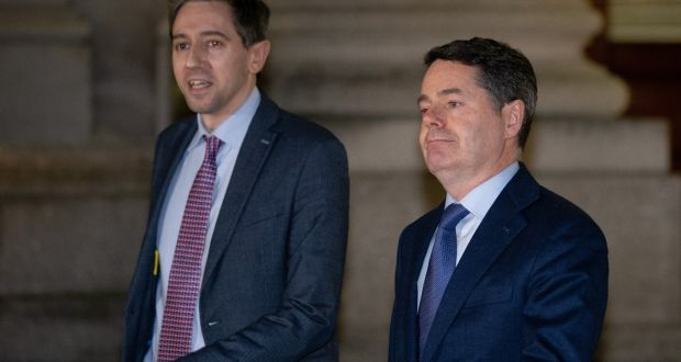 Minister for Health Simon Harris and Minister for Finance  Paschal  Donohoe speaking to the media at Government Buildings on Monday night. Photograph: Tom Honan