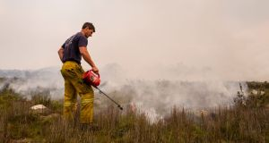 Unsung heroes: Members from the Tasmania Fire Service working to control the recent bushfires. Photograph: Heath Holden/Getty Images