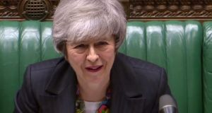 Britain's prime minister Theresa May listening to a reply by opposition leader Jeremy Corbyn to her statement on Brexit in the House of Commons in London. Photograph: AFP/Getty Images