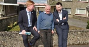 The SDLP's Daniel McCrossan (left), local man Eamon Holland (centre), and SDLP leader Colum Eastwood during election  canvassing in Strabane in 2018