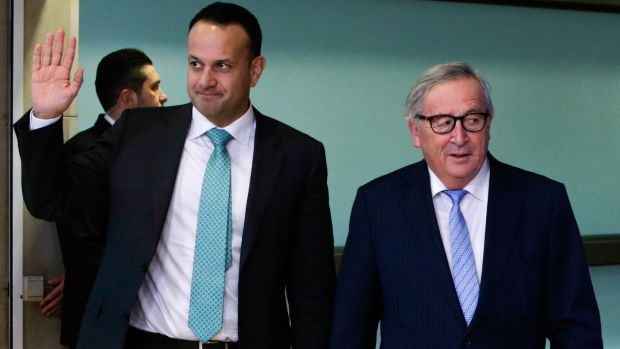 Taioseach Leo Varadkar waves as he walks past European Commission president Jean-Claude Juncker at the European Commission headquarters in Brussels on February 6th. Photograph: Aris Oikonomou/AFP/Getty Images