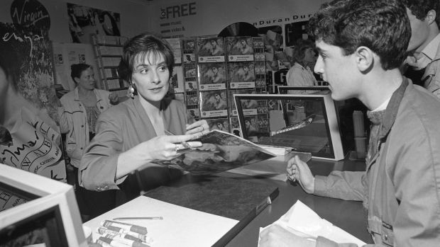 Enya signsign autographs in the Virgin megastore in Dublin in 1988. Photogrpah: Getty