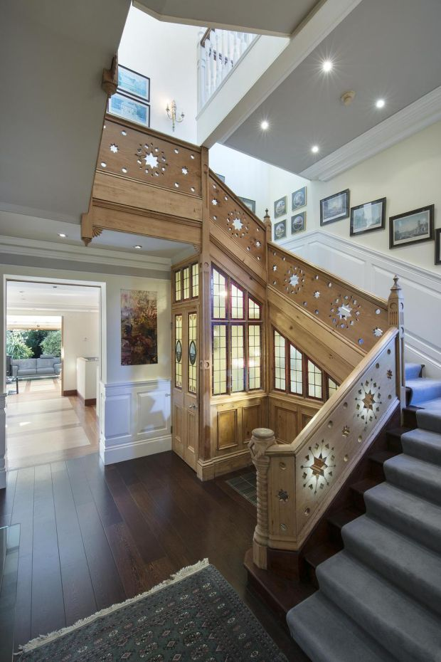A 24ft central atrium is the fulcrum of the house and a stripped-back pitch pine staircase with circular star-carved motifs forms the centrepiece.