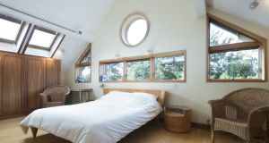 On the top floor a large bedroom was added  with maple finish, pitched ceilings, dual aspect windows – including a large porthole – and views to the garden below