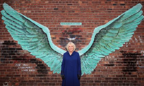 WINGS: The Duchess of Cornwall Camilla stands between the wings of artist Paul Curtis' mural entitled 'For All Liverpool's Liver Birds', in Liverpool's Baltic Triangle on February 12th. Photograph: Peter Byrne/PA Wire