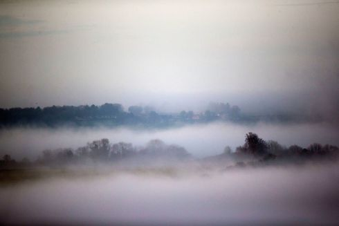 LONG VIEW: Mist sits over the trees in Lambourn, Berkshire. Photograph: Steve Parsons/PA Wire
