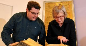 Gary Brannan and Sarah Rees Jones examine one of the archbishops' registers.  Photograph: University of York/Guardian