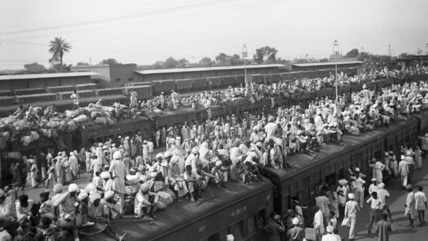 Indian refugees crowd on to trains as a result of the creation of two independent states, India and Pakistan, in 1947. Muslims flee to Pakistan and Hindus flee to India in one of the largest transfers of population in history. Photograph: Getty Images